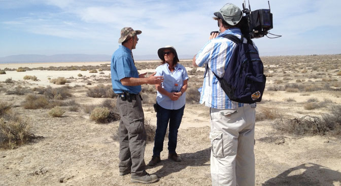 A PBS cameraman records footage of a discussion between environmental engineer Vic Etyemezian of the Desert Research Institute and NASA Dryden occupational health scientist Miriam Rodon-Naveira for a feature story on their Valley Fever research study to be aired on the PBS News Hour in June.