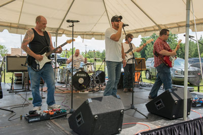 The Huntsville-area rock band Back Road Sinners was among several local music acts that performed throughout the day's activities, courtesy of the MARS Music Club.