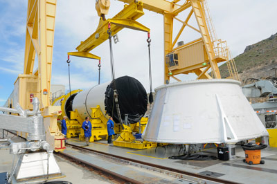 The center aft segment for qualification motor-1 (QM-1), a full-scale version of a solid rocket motor for the Space Launch System (SLS), was transported May 29 from a manufacturing area to its test area at ATK�s facility in Promontory, Utah.