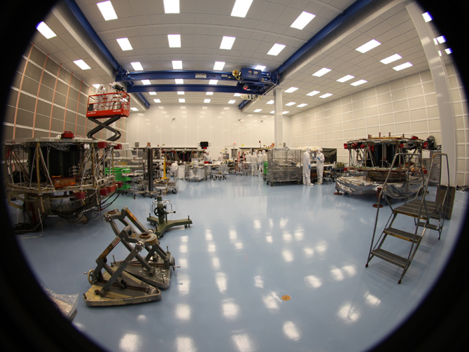 This fisheye image shows the four MMS observatories inside the cleanroom at Goddard.
