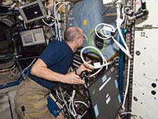 NASA astronaut Don Pettit works with the Structure and Liftoff in Combustion Experiment (SLICE) at the Microgravity Science Glovebox (MSG) in the Destiny laboratory of the space station during Expedition 30. Pettit will be a guest speaker at the second annual International Space Station Research and Development. (NASA)
