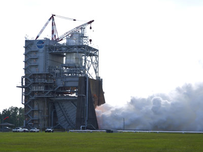 J-2X engine No. 10002 is tested June 14 on the A-1 test stand at NASA's Stennis Space Center. The 60-second test signals the start of a series of firings to collect critical data on engine performance.