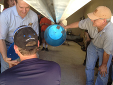 UP Aerospace personnel load one of the technology payloads into the nose of the firm's SpaceLoft 7 sounding rocket in their facility at Spaceport America in New Mexico. Seven experiments were to be carried aboard the SL7 into sub-orbital space on its June 21 launch.