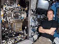 NASA astronaut Tom Marshburn with the Light Microscopy Module aboard the International Space Station. (NASA)