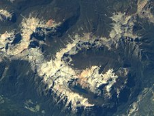 This ISERV image shows the towering, snow-topped mountains and deeply carved valleys of the Chilean Andes. (SERVIR/ISERV)