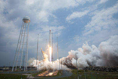 The Orbital Sciences Corporation Antares rocket launches from Pad-0A with the Cygnus spacecraft onboard, Sunday, July 13, 2014, at NASA's Wallops Flight Facility in Virginia.