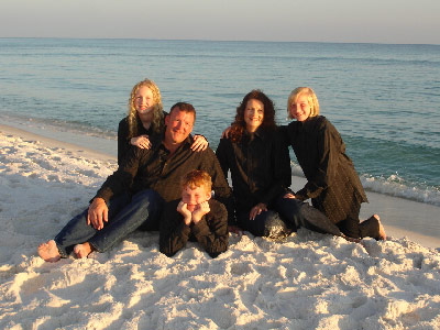 The Hawkins family, from left, Katelyn, Jim, David, Jennifer and Abigail, visits the beach in Destin, Fla., a few weeks before Jennifer was diagnosed with Leukemia in 2008.