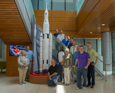 A 1/25 scale model of the Space Launch System was recently built by the Office of Strategic Analysis & Communications Public and Employee Communications Office exhibits team and positioned in the new Building 4220 lobby at the Marshall Space Flight Center.