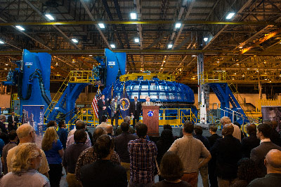 With the Space Launch System (SLS) in the background, NASA Administrator Charles Bolden spoke Monday during a visit to the agency's Michoud Assembly Facility in New Orleans. Bolden was joined by Sen. David Vitter of Louisiana to observe progress made on the SLS.