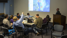 Researchers review proposed IceBridge flight lines during mission's science team meeting at NASA Goddard.