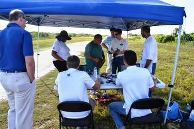 "The Marshall Center's ""Aero-M"" team assembles its unmanned aerial system, or UAS, shortly before taking flight at the Kennedy Space Center."