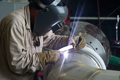 A welder at NASA's Stennis Space Center works on a portion of piping to be installed on the A-1 test stand for RS-25 rocket engine testing. NASA is scheduled to begin testing RS-25 engines in 2014 for use on the Space Launch System.