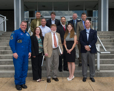 From left, first row, astronaut T.J. Creamer; and honorees Stacie E. Gooch, Stages Office; Carey G. Thompson, Program Planning & Control Office; Erin M. Betts, Propulsion Systems Department; Douglas N. Reeves, Ground Operations Liason Office; second row, Van A. Woodruff, Mission Operations Laboratory; Joseph H. Ruf, IV, Propulsion Systems Department; Stephen D. Creech, Space Launch Systems Program Office; third row, Daniel R. Dennis, Space Systems Department; T. Emerson Oliver, Spacecraft & Vehicle Systems Department; and Richard N. Grugel, Materials & Processes Laboratory.