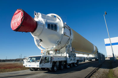 A Delta IV booster is moved out of the United Launch Alliance (ULA) facility in Decatur.