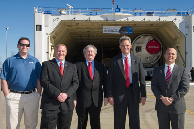 Looking on as the United Launch Alliance (ULA) boosters are loaded onto the Mariner cargo barge at ULA's facility in Decatur, are from left, Greg Jenkins, ULA representative; Corey Brooker, Lockheed Martin Orion systems and launch vehicle integration; Bill Hill, NASA assistant deputy associate administrator for exploration systems; Paul Marshall, NASA Orion program assistant manager for strategy integration; and Larry Gagliano, NASA Orion project manager at the Marshall Center.