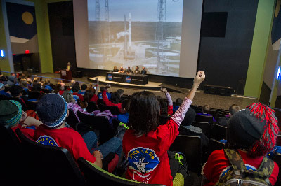Students attending Space Camp eagerly ask questions of the deep space exploration panel at the MAVEN public viewing event at the Space & Rocket Center.