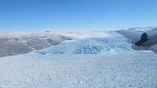 View from the P-3 flight station of the calving front of a southwest Greenland glacier.