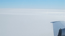 Clear blue skies and the flat expanse of Antarctic ice seen from the NASA P-3