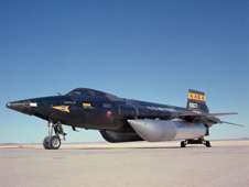Dark-colored X-15 rocket plane on a runway