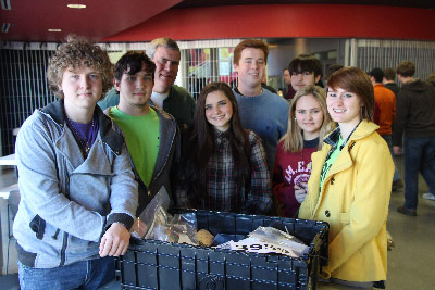 "Student leaders on the Morgan County ""Mech Tech"" robotics team pick up a kit of parts during the 2014 FIRST Robotics Competition kickoff at the U.S. Space & Rocket Center."