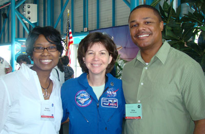 Nadra Hatchett, left, an aerospace engineer and technical assistant in the Marshall Center's Office of the Center Director, enjoys a visit to the Kennedy Space Center in 2010 as a Space Flight Awareness honoree. With her are her husband Ollie, right, and NASA astronaut Cady Coleman.