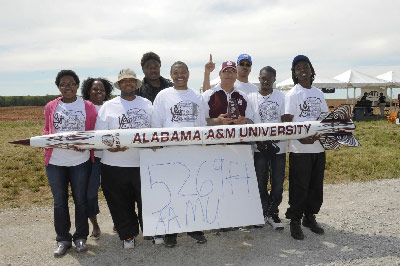 "In 2013, the ""Altitude Award,"" presented annually to the team that comes closest to the 1-mile altitude goal without going over it, went to the team from Alabama A&M University in Huntsville. Their rocket flew to an altitude of 5,269 feet -- just 11 feet short of the goal, a record-setting achievement. (MSFC/Emmett Given)"