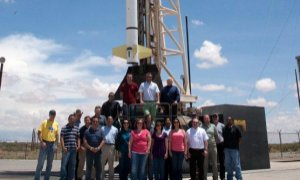 Team members pose with the H-C sounding rocket.