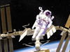 Astronaut in spacesuit floating near the space station