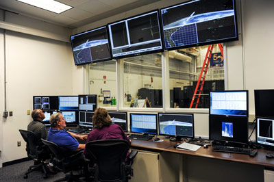 From left, Wayne Arrington and Richard Gilbert, both Boeing employees supporting Marshall's Stages Office; and Lisa Coe, an engineer in the Stages Office, perform a demonstration of a SLS fly-out from the System Integration Test Facility control room. This demonstration goes from prelaunch to all the stages of the vehicle separation events, including booster separation, engine cut off and Orion spacecraft separation.