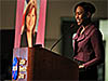 Margot Lee Shetterly standing at a podium