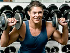 A young man lifting weights