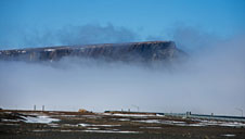Greenland's Mount Dundas peeking through a layer of fog near Thule Air Base on May 11, 2014.