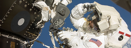 Astronaut performing a space walk.