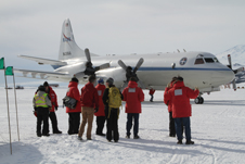 Members of the IceBridge team greet the NASA P-3 after its first landing on McMurdo Station's sea ice runway.