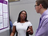 NASA intern Qi'Anne Knox speaks with an attendee at a poster session