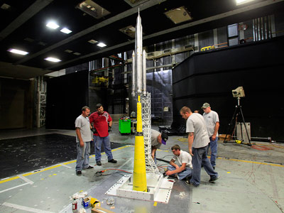 NASA engineers and contractors tested four different payload configurations during the liftoff transition testing of a 67.5-inch model of the SLS at NASA Langley Research Center's 14-by-22-foot subsonic wind tunnel.