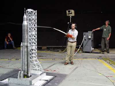 During the liftoff transition testing of a nearly 6-foot model of the SLS, engineers used a technique for studying airflow streamlines called smoke flow visualization, giving them insight into the data retrieved.