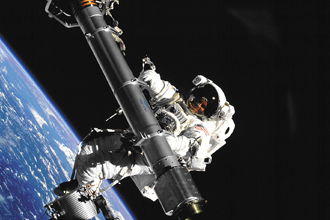 Astronaut conducting extra-vehicular activities in space.