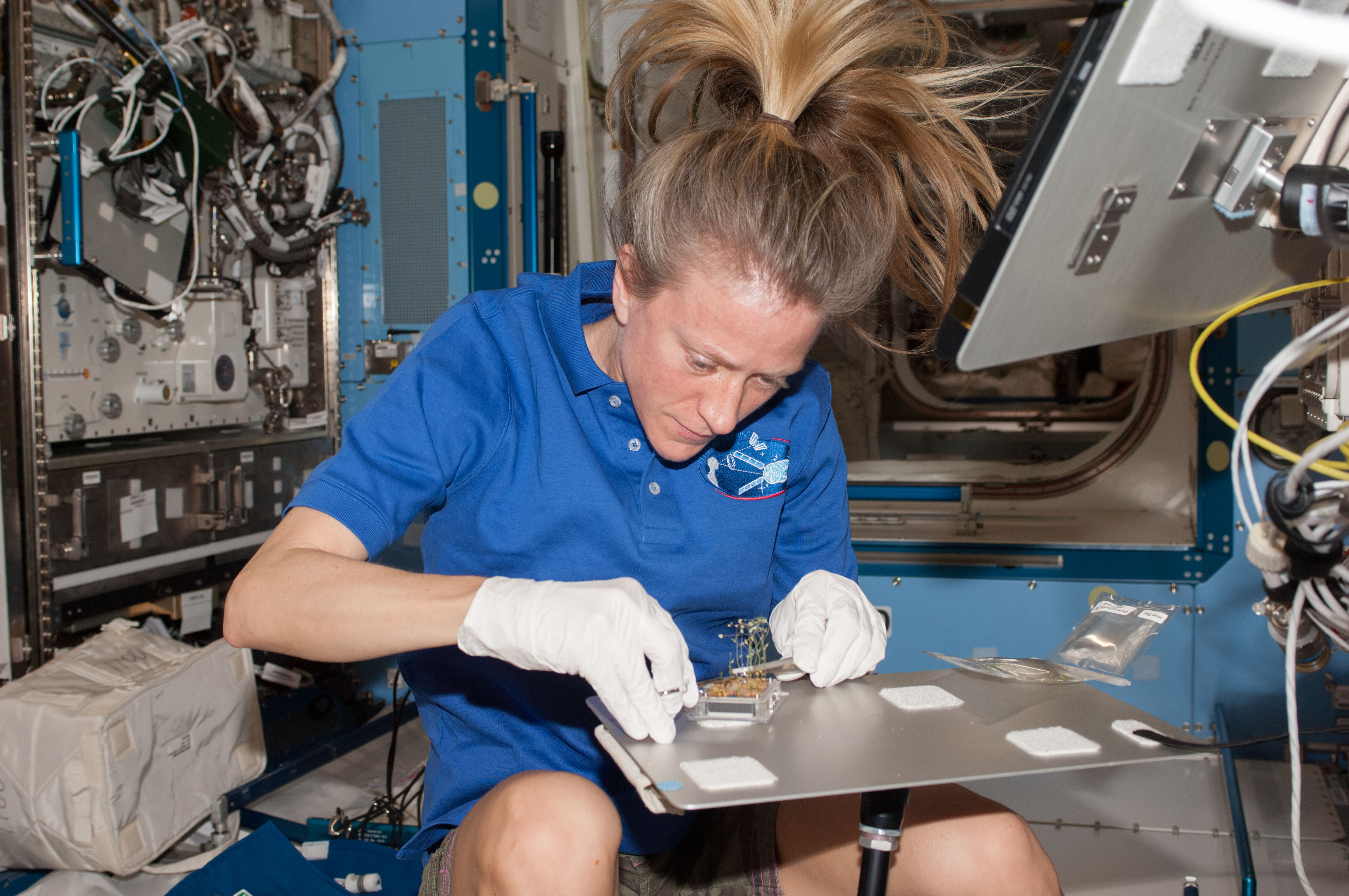 female astronaut drinking water in space - photo #7