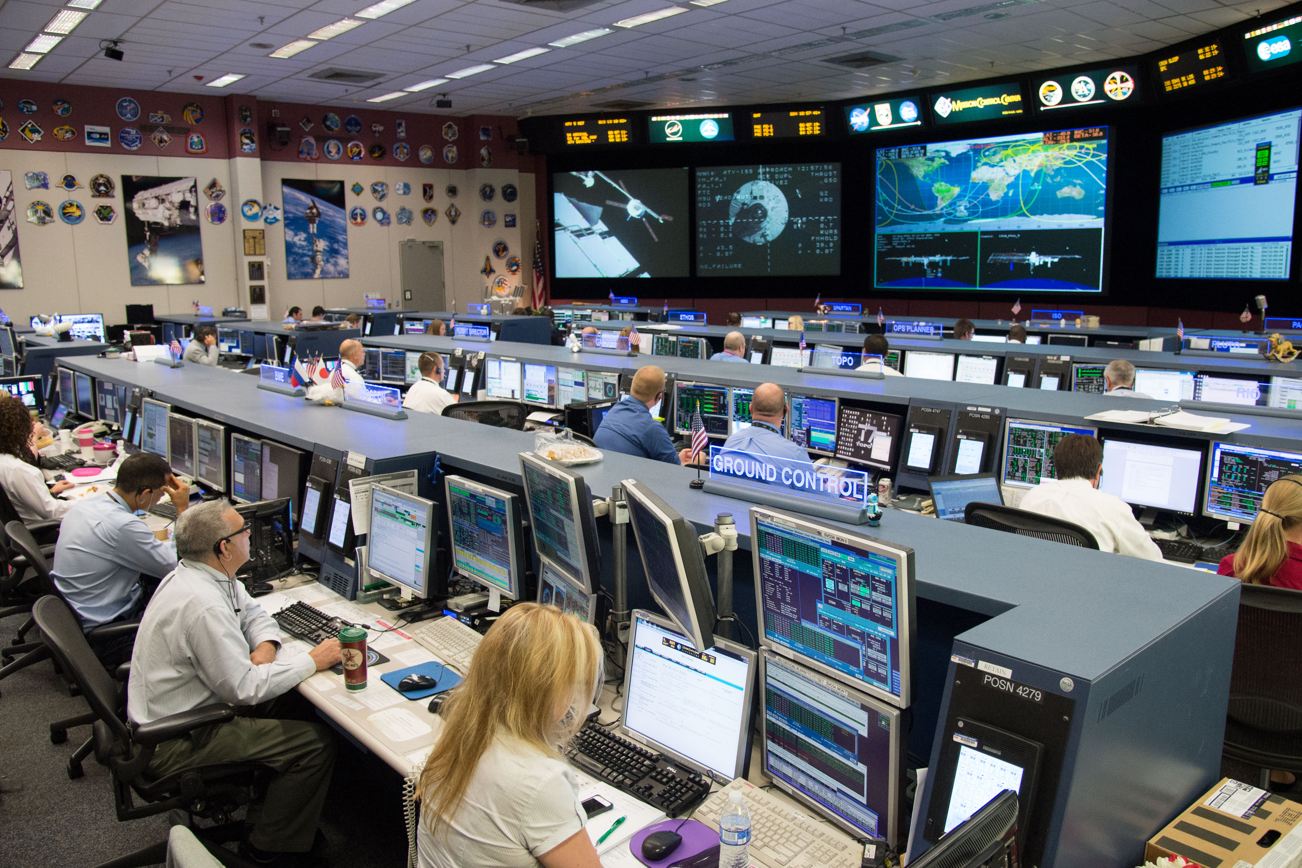 Mission Control Monitor : Houston mission control team at work for atv docking to