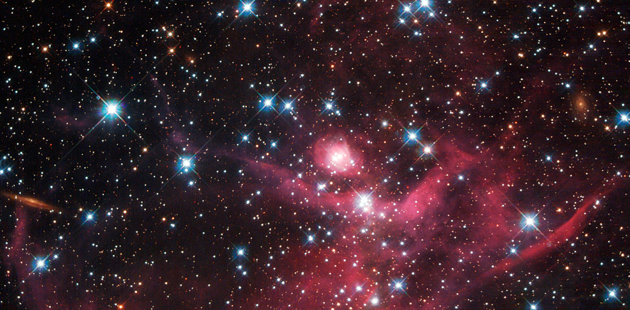 Hubble Catches Cosmic Cloak of Red   NASA