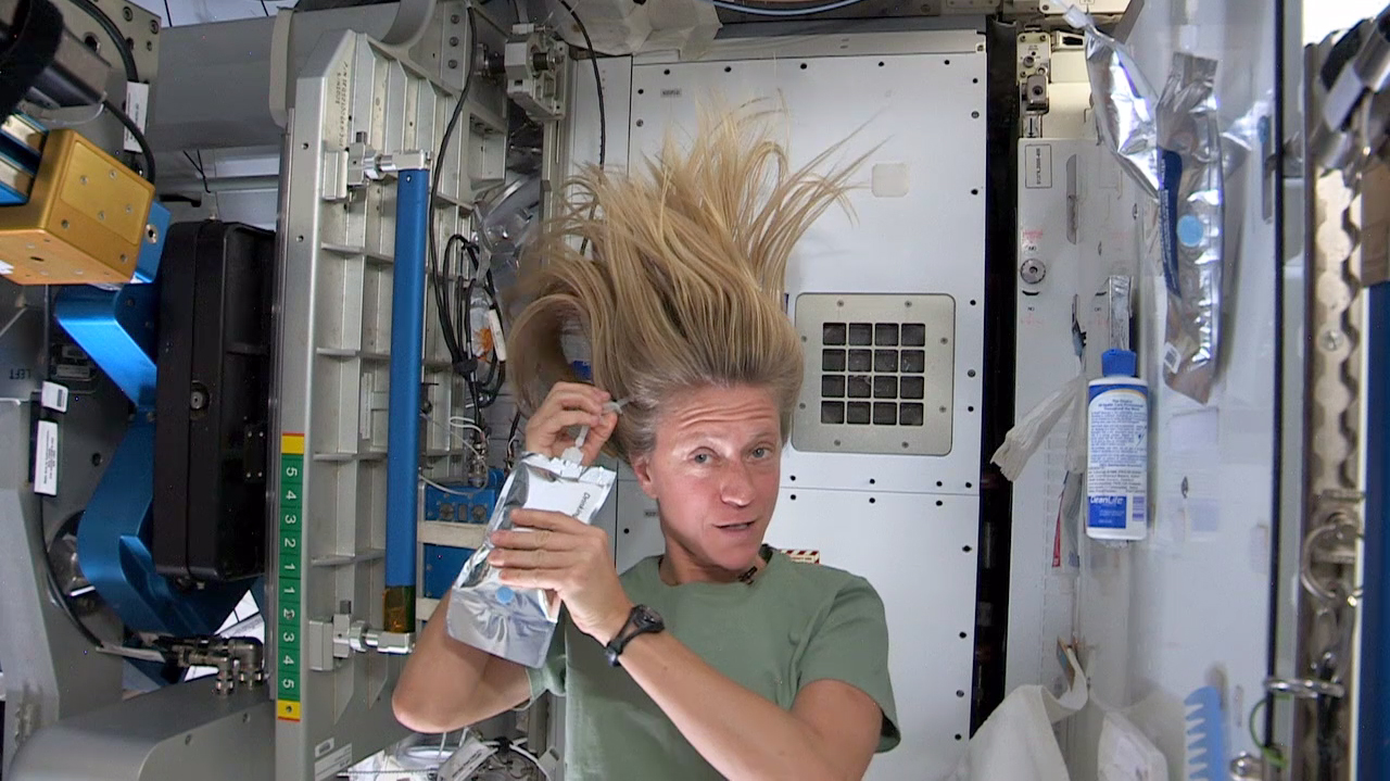 astronaut washing her hair in space - photo #7