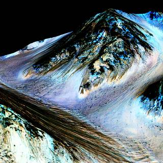 NASA Confirms Evidence That Liquid Water Flows on Today?s Mars