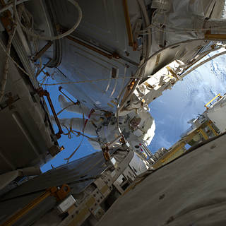 NASA astronaut Shane Kimbrough in space suit working outside the International Space Station