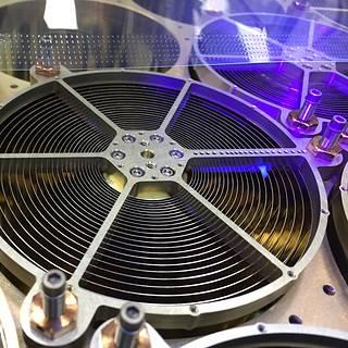 Closeup of circular optics with black light above