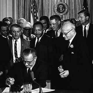 President Lyndon B. Johnson signing the Civil Rights on July 2, 1964.