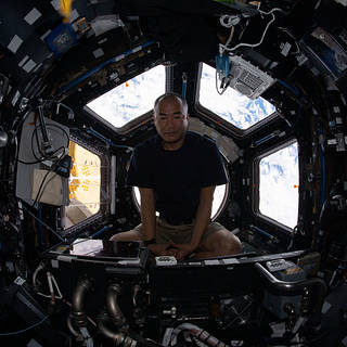 Expedition 64 Flight Engineer Soichi Noguchi relaxes inside the cupola