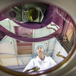 Electronics technician Anna Noe makes final checks to the Doppler Aerosol Wind Lidar (DAWN)