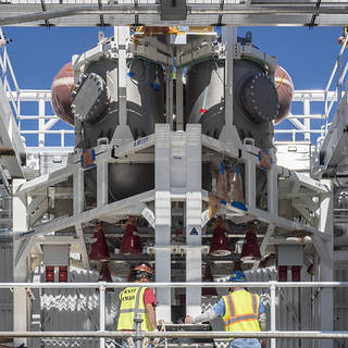 Service module insallation on Orion spacecraft