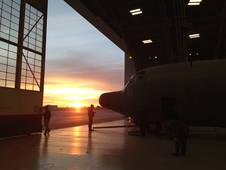The hanger doors open on a new day of flight tests for the C-130 IceBridge aircraft.